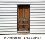 1800s Civil War era doorway framed in white siding