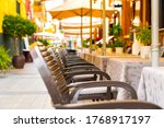 chairs and tables in an outdoor ... | Shutterstock . vector #1768917197