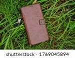 Closed Brown Leather Case With...