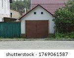 Facade Of A White Garage With...