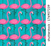 vector seamless pattern with pink flamingos on turquoise background