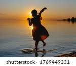 Silhouette Of A Spinning Girl...