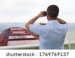 Navigator On The Bridge Of A...