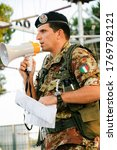 Small photo of Bari, Puglia/ Italy - October 26 2012: A Italian man officer issues orders to train a platoon of reservists from the Italian Army for rope climbing training activities
