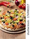 pizza vegetarian on plate | Shutterstock . vector #176980217