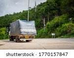 Chiang Mai / Thailand - June 2020 : A heavy truck vehicle that carry goods is parking for take a break during drive up to hill area highway. Transportation and logistic industrial editorial photo. - stock photo