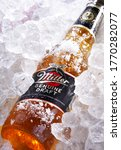 Small photo of POZNAN, POL - MAY 28, 2020: Bottle of Miller Genuine Draft, the original cold filtered packaged draft beer, a product of the Miller Brewing Company owned by SABMiller
