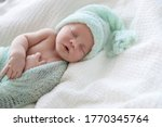 Cute Newborn Baby In Warm Hat...