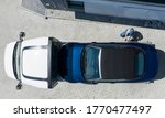 Modern Brand New Convertible Car on Towing Truck Delivered to Client Home. Aerial View. Transportation and Car Sales Theme. - stock photo
