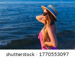 Young Woman In Boater And Pink...