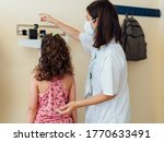 The Pediatric Doctor Checks The ...
