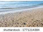 Sandy Beach With Sea Pebbles...