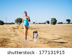 Woman And Dog Running In...