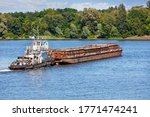 River Tugboat Pushes An Empty...