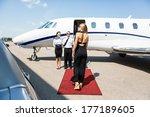 rear view of rich woman walking ... | Shutterstock . vector #177189605