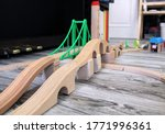 Bridge and elements of a toy wooden railway in the game room. Wooden road, as a means for playing at home, in kindergarten or school. - stock photo