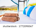 Rolled Beach Towels Laying On A ...