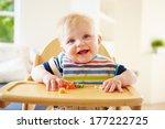 baby boy eating fruit in high... | Shutterstock . vector #177222725