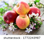 Apple And Blossoms On Wooden...