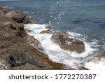 Waves Crashing Against The...