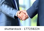 two businessman shaking hands | Shutterstock . vector #177258224