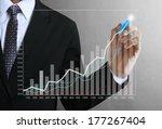 business man hand drawing a... | Shutterstock . vector #177267404