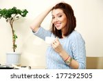 happy woman holding cup with... | Shutterstock . vector #177292505