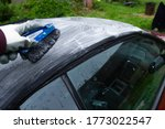 cleaning the tarpaulin roof top  of the convertible with foam cleaner. - stock photo