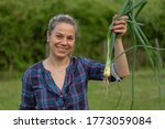 young happy woman farmer ...