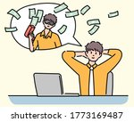 A Businessman Is Sitting At A...