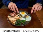 A Man Eats Eggs In A Restaurant
