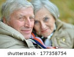 mature couple walking in the... | Shutterstock . vector #177358754