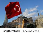 A Person Waves A Turkish Flag...