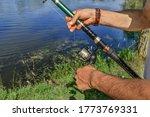 A Fisherman Wraps Fishing Line...