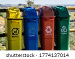 Small photo of CUNHA, SAO PAULO / BRAZIL - AUG 16, 2019: Plastic waste containers used to segregate metals, papers, plastic and glass materials for recycling at the fencing of the viewing spot of O Lavandario farm.