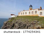 Lighthouse And Dwellings At...