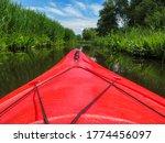 Red Tourist Kayak. Peddeling On ...