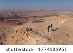 Hikers On A Hiking Trail In...