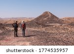 Two Male Hikers On A Hiking...
