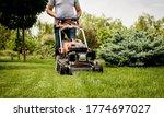 Gardener Mowing The Lawn....