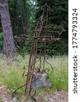 Rusty Carved Metal Cross On An...