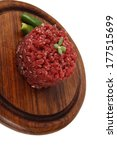 very big raw hamburger cutlet with sprouts and chili pepper on wooden plate isolated over white background - stock photo