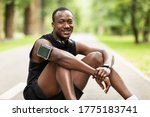 Happy Black Sportsman Sitting...