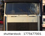 Small photo of Broken windshield of a truck (lorry). Accident and traffic accident. The crash. A gunshot attack on a car. Abandoned truck after an accident
