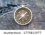Round Compass On Blue Wooden...