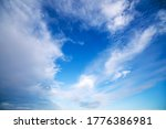 Blue sky with dramatic white clouds on a bright and windy day