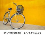 A Yellow Retro Bicycle Parking...