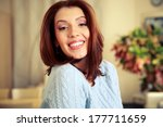 portrait of a smiling woman at... | Shutterstock . vector #177711659