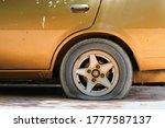 Gold Car Old  Flat Tire With...