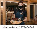 a pretty waitress who wears a...